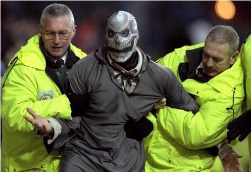 Masked Man Led Away